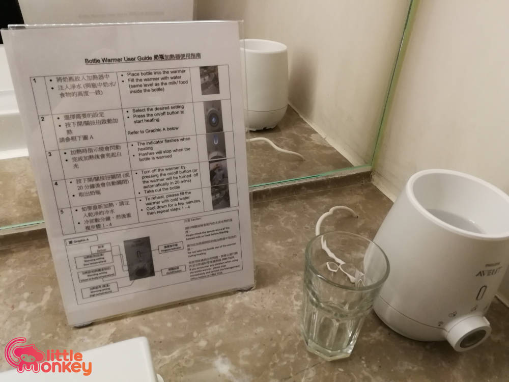Hysan Place's Bottle warmer with user guide of baby changing station
