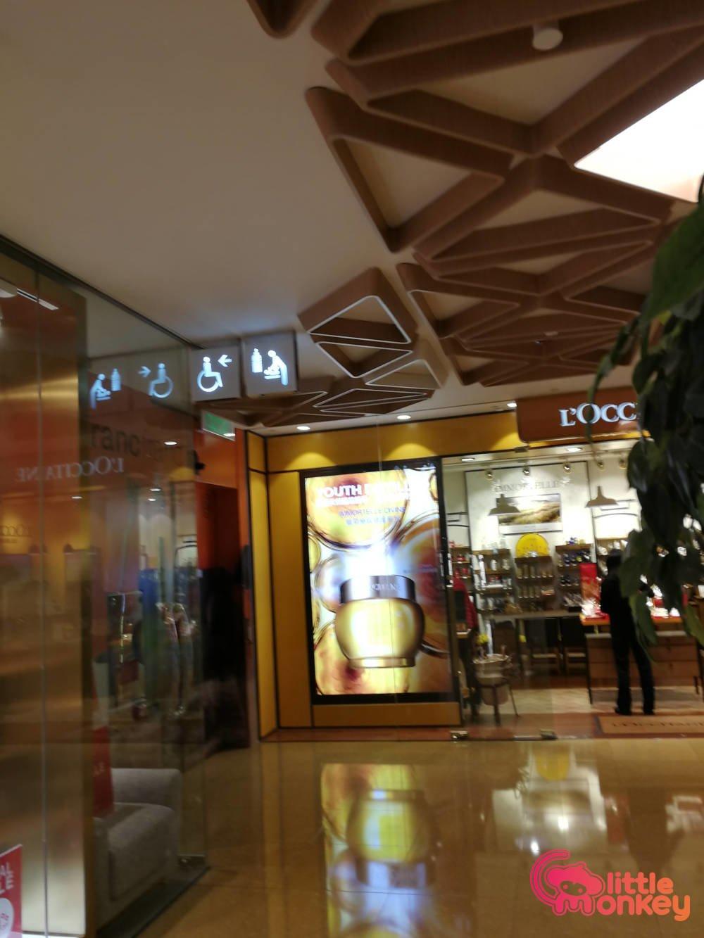 Cityplaza's mall signage near L'OCCITANE