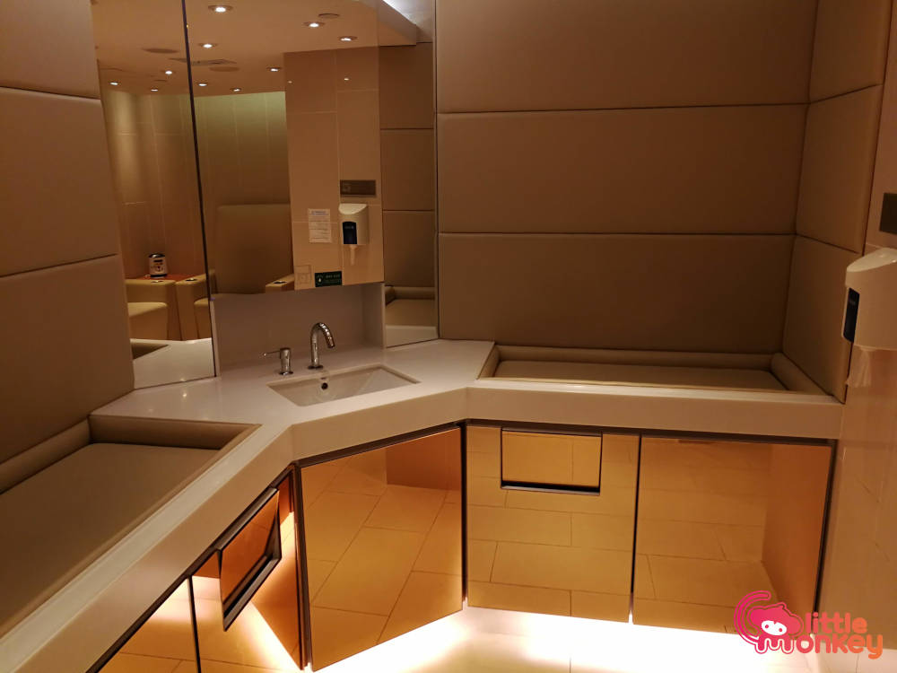 Nursery room's basin and changing stations in Harbour City