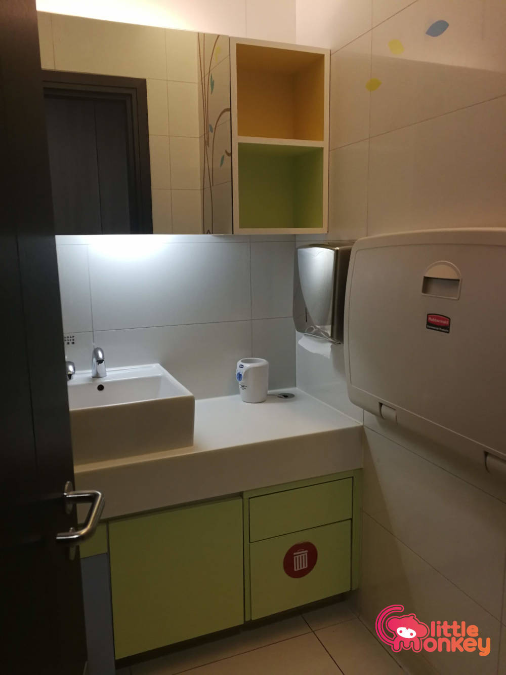 Nursery room's basin and changing station in iSquare