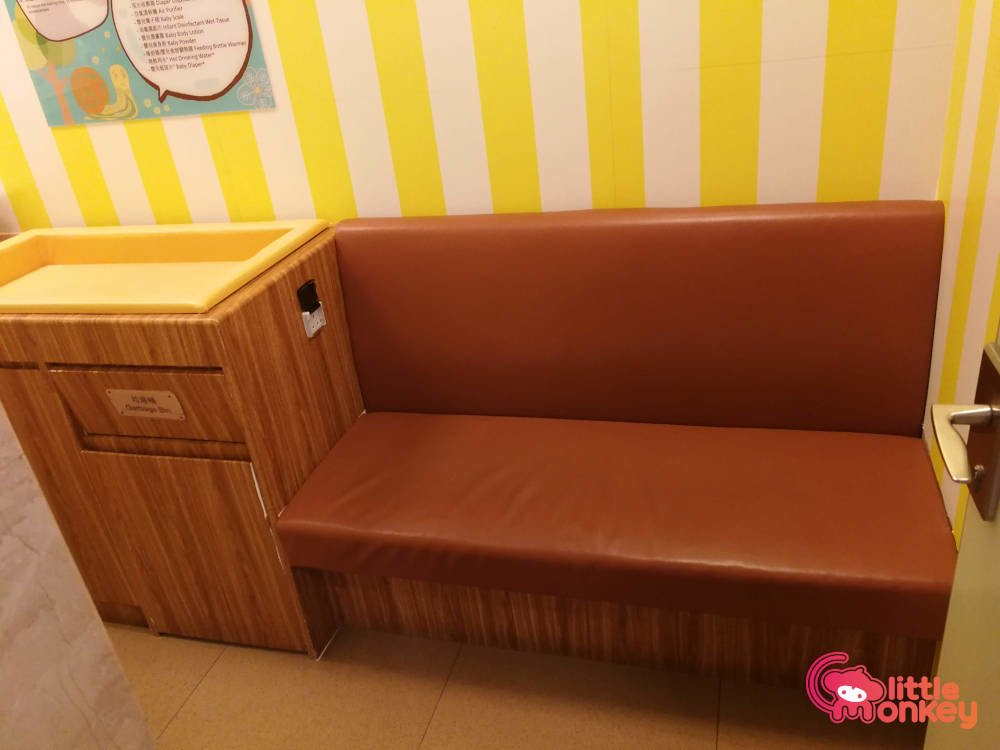 Nursery room's changing station and couch in K11